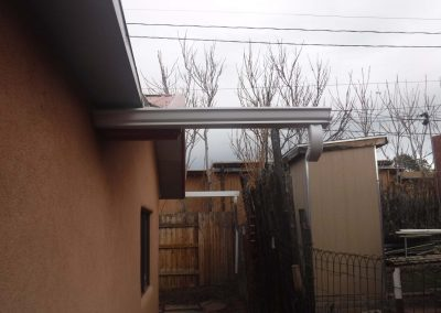 Seamless rain gutter on a pitched roof home.